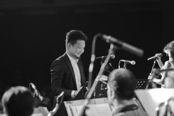 Ricky Lionardi conducting Ron King Big Band, accompanying Dira Sugandi at Java Jazz Festival 2014 (photo by Melon Lemon)